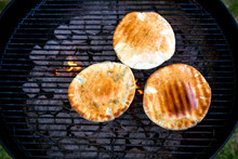 Close Up Of Breads On Barbecue Grill