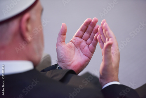 Elderly Muslim Arabic man praying during islamic conference