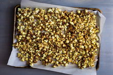 Overhead View Of Coconut Sugar Caramel Popcorn On Parchment Paper