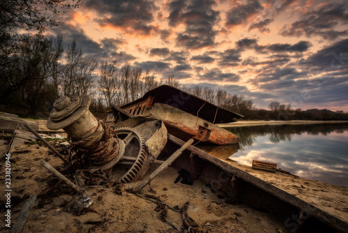 Rusty abandoned ship wreck in ship graveyard with dramatic effect