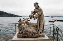 Statues Of Saint Francis With Jesus Child On Lake Maggiore In Laveno Mombello, Italy