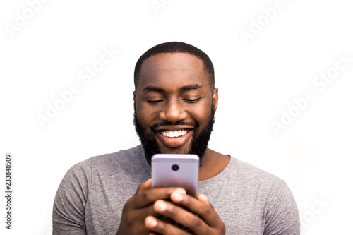 African American black user holding mobile smart phone near