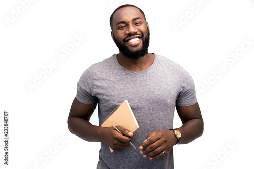 Confident professional African American local newspaper journalist prepares a material article for his column Canvas-taulu