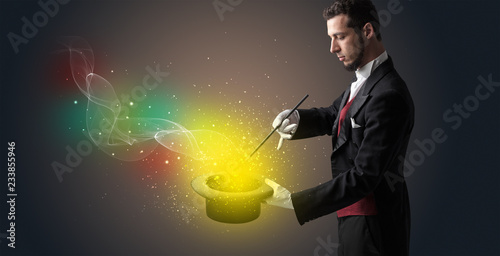 Obraz na plátně Illusionist hand starts to conjure with white glove and magic wand
