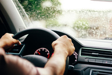 Driver Driving Car Safely On Rainy Day