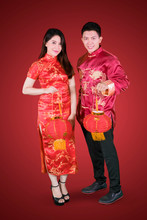 Young Couple Holds Lantern At Chinese New Year
