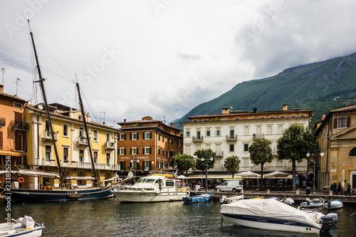 Foto op Aluminium Stad aan het water Malcesine, Italy: Boats on embankment of Garda lake in spring, Lombardy.