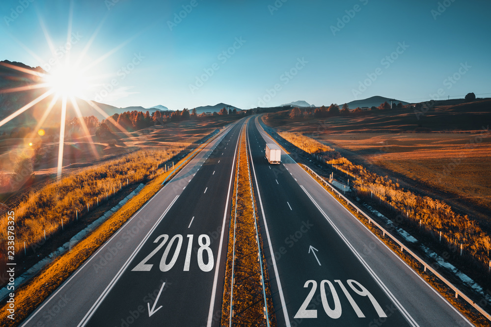Fototapeta Driving on open road at beautiful sunny day from 2018 to new year 2018