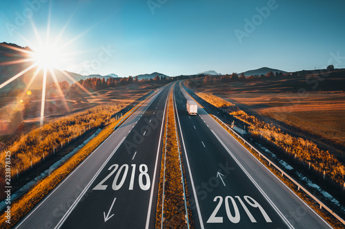 Fototapeta Driving on open road at beautiful sunny day from 2018 to new year 2018 obraz