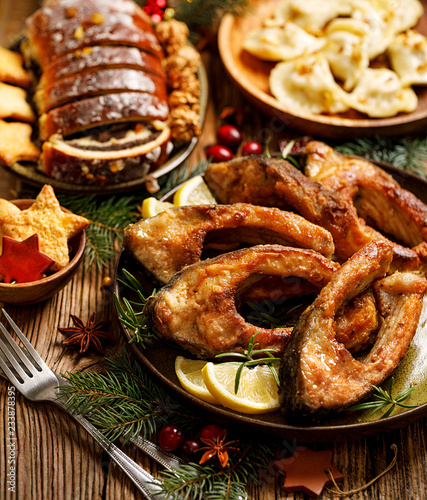 Canvas Prints Ready meals Christmas carp, Fried carp fish slices on a ceramic plate, close up, top view. Traditional christmas eve dish. Polish Christmas
