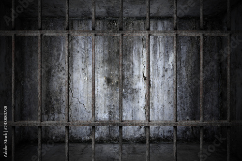 Fototapeta  Old prison rusted metal bars cell lock with dark and bright in the jail