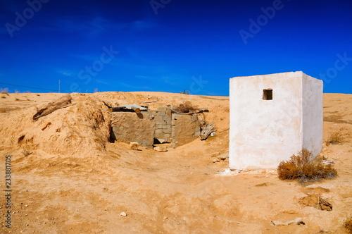 White building in Sahara desert, Tunisia, North Africa Wallpaper Mural