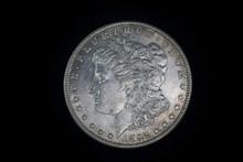 Old Silver Dollar Coin With Liberty Head On Black Background