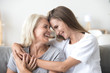 Leinwanddruck Bild Happy loving older mature mother and grown millennial daughter laughing embracing, caring smiling young woman embracing happy senior middle aged mom having fun at home spending time together