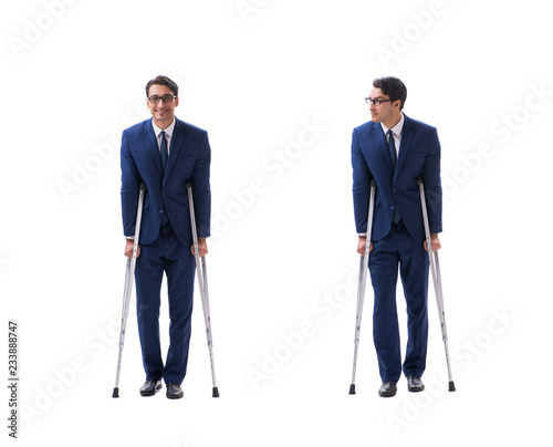 Tela Businessman walking with crutches isolated on white background