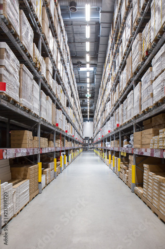 Rows of shelves with goods boxes in modern industry warehouse store at factory warehouse storage Wall mural