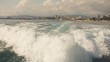 A slow motion view of the wake behind a sports boat at sea