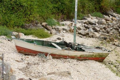 Fotografía  wooden fishing boat on the shore