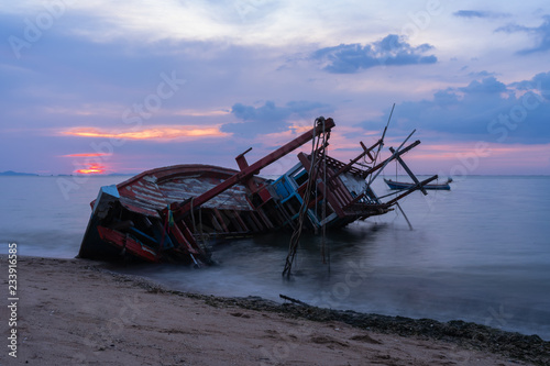 Old fishing boat shipwrecks disposed on the beaches of the