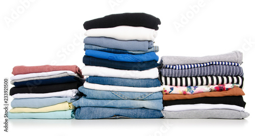 Fotografía  A stack of clothes jeans t-shirt shirt on a white background