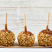 Caramel Apples On Wooden Background. Selective Focus.