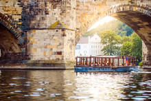 Prague, Bohemia, Czech Republic. Sunset Aerial View Of The Old Tour Boat And Bridge Under Vltava River In Praha.