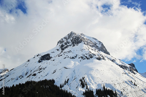 Fotobehang Antarctica Mountain with Blue Sky and White Clouds in Lech, Austria