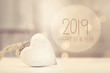canvas print picture - New Year 2019 message with a white heart  in a room