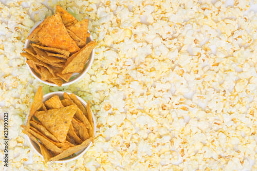 In de dag Buffet, Bar two buckets of nachos on the background of scattered popcorn, with space for writing