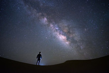 Milky Way Galaxy With A Man Standing And Watching At Tar Desert, Jaisalmer, India. Astro Photography.