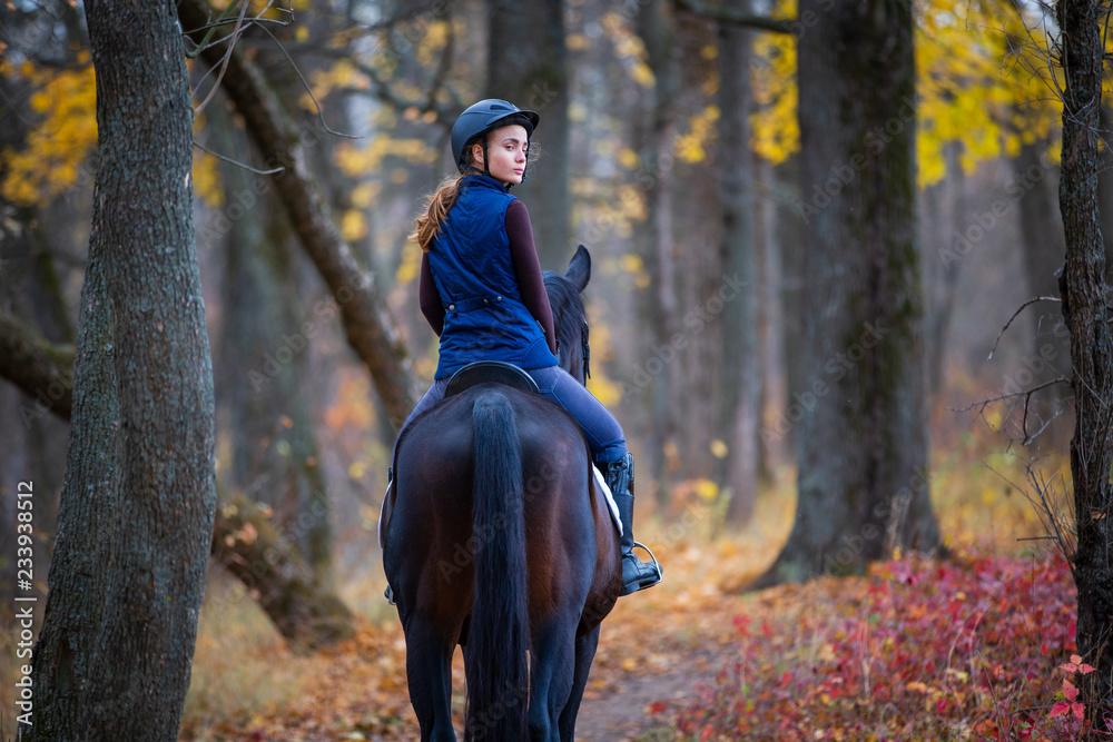 Fototapety, obrazy: Teenage girl riding horse in autumn park
