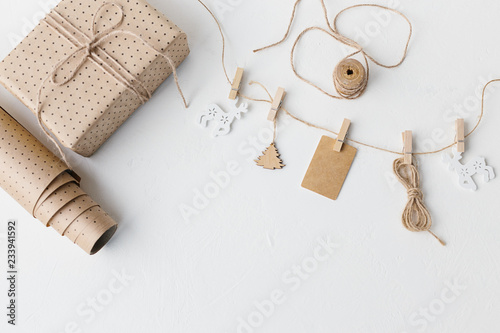 Fotomural  Scandinavian christmas composition, wrapped craft paper gift.