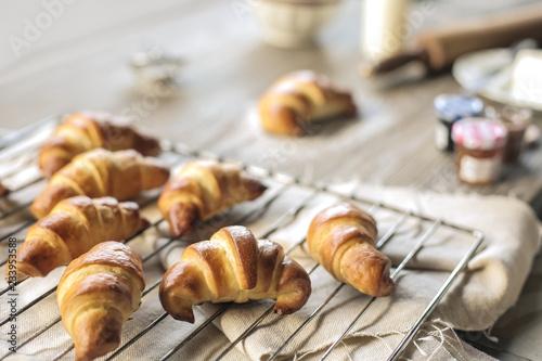 Fotografie, Obraz  Fresh hand made croissant on a baking pan