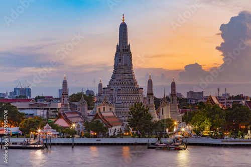 Poster Antwerp Arun temple river front with sunset sky background, Thailand landmark