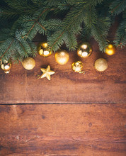 Christmas Background. A Lot Of Gold Baubles And Fir Tree