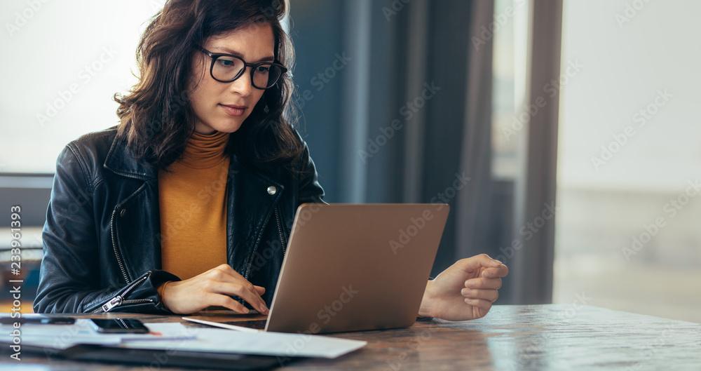 Fototapeta Asian woman working laptop at office