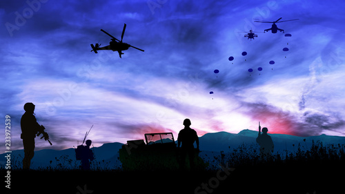 Silhouette of soldiers at night watching the launch of paratroopers Fototapeta