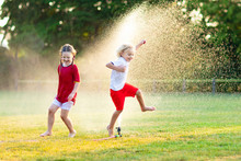 Kids Play With Water. Child Wi...