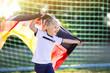 Leinwandbild Motiv Germany football fan kids. Children play soccer.