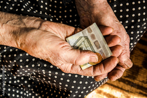 Old retired woman holding cash euros in her rough hard working hands Tapéta, Fotótapéta