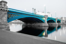 Long Exposure Of Bridge In Nottingham, UK, With Reflecting Lights And Embankment