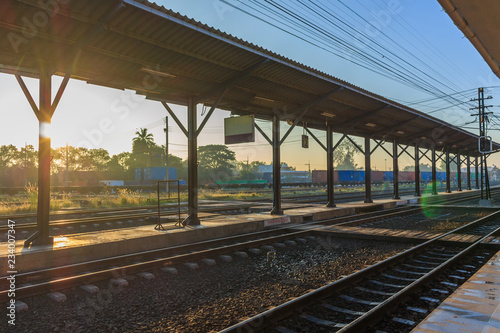 Railway platform in the early morning sun.