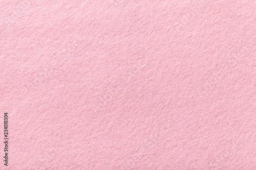 Valokuva  Light pink matt suede fabric closeup. Velvet texture of felt.