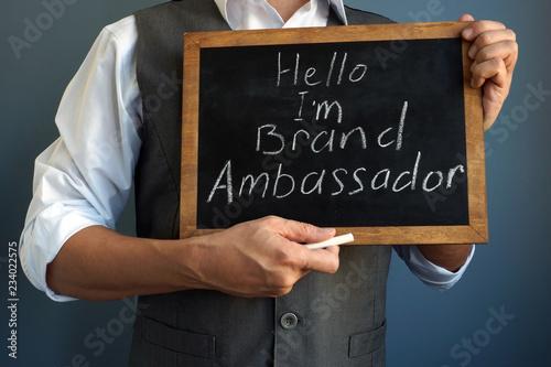 Man is holding blackboard with sign I am Brand Ambassador. Canvas Print
