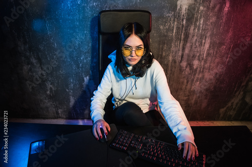 Beautiful Professional Gamer Girl Playing in First-Person Shooter Online Video Game on Her Personal Computer Wallpaper Mural