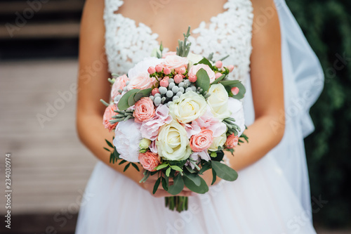 closeup of bride hands holding beautiful wedding bouquet Canvas Print