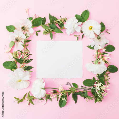 Foto op Canvas Bloemen Floral frame of white flowers, buds with card on pink background. Flat lay, top view. Pastel background.