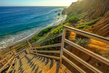 Scenic Wooden Stairway Leading Down To El Matador State Beach At Sunlight. Pacific Coast, California, United States. Pillars And Rock Formations Of Most Photographed Malibu Beach, Popular Spot Shot.
