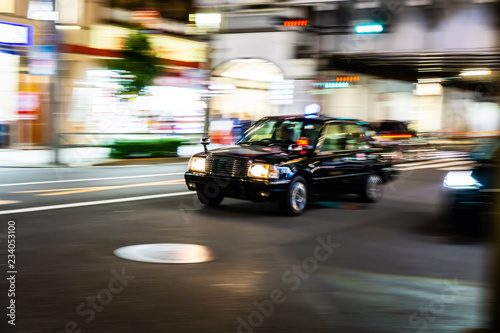 Staande foto New York TAXI Japanese taxi fast speed drive on asphalt road at night (Ueno area, Tokyo, Japan)