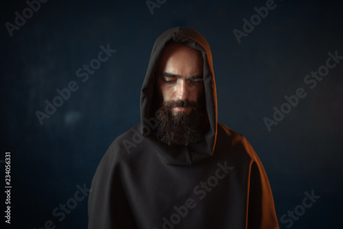 Cuadros en Lienzo Portrait of medieval monk in black robe with hood